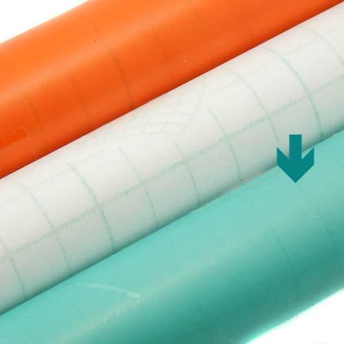Folie entspiegelt, 3 Rollen selbstklebende Klöppelfolie entpiegelt in den Farben orange, farblos und blau, in der Klöppelwerkstatt erhältlich, die Farbe blau ist markiert