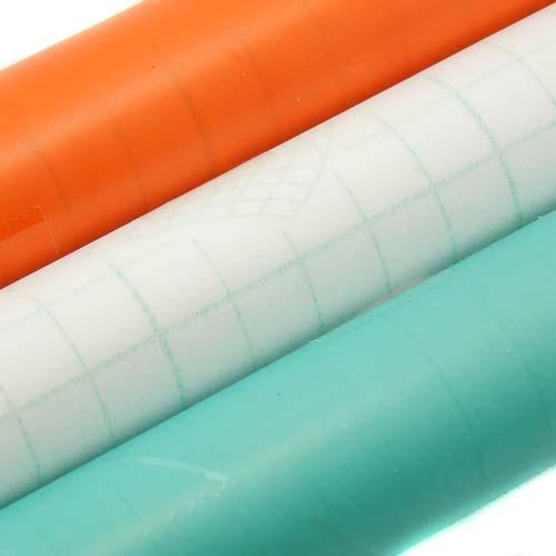 Folie entspiegelt, 3 Rollen selbstklebende Klöppelfolie entpiegelt in den Farben orange, farblos und blau, in der Klöppelwerkstatt erhältlich