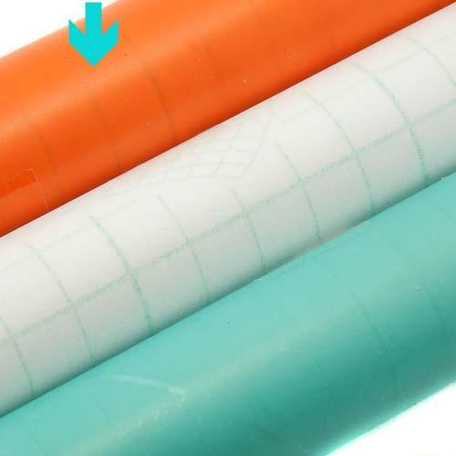 Folie entspiegelt, 3 Rollen selbstklebende Klöppelfolie entpiegelt in den Farben orange, farblos und blau, in der Klöppelwerkstatt erhältlich, die Farbe orange ist markiert
