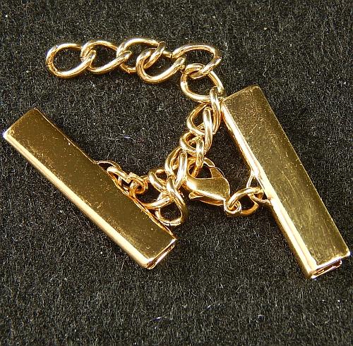 Klemme mit Verlaengerungskette und Karabiner 25mm gold